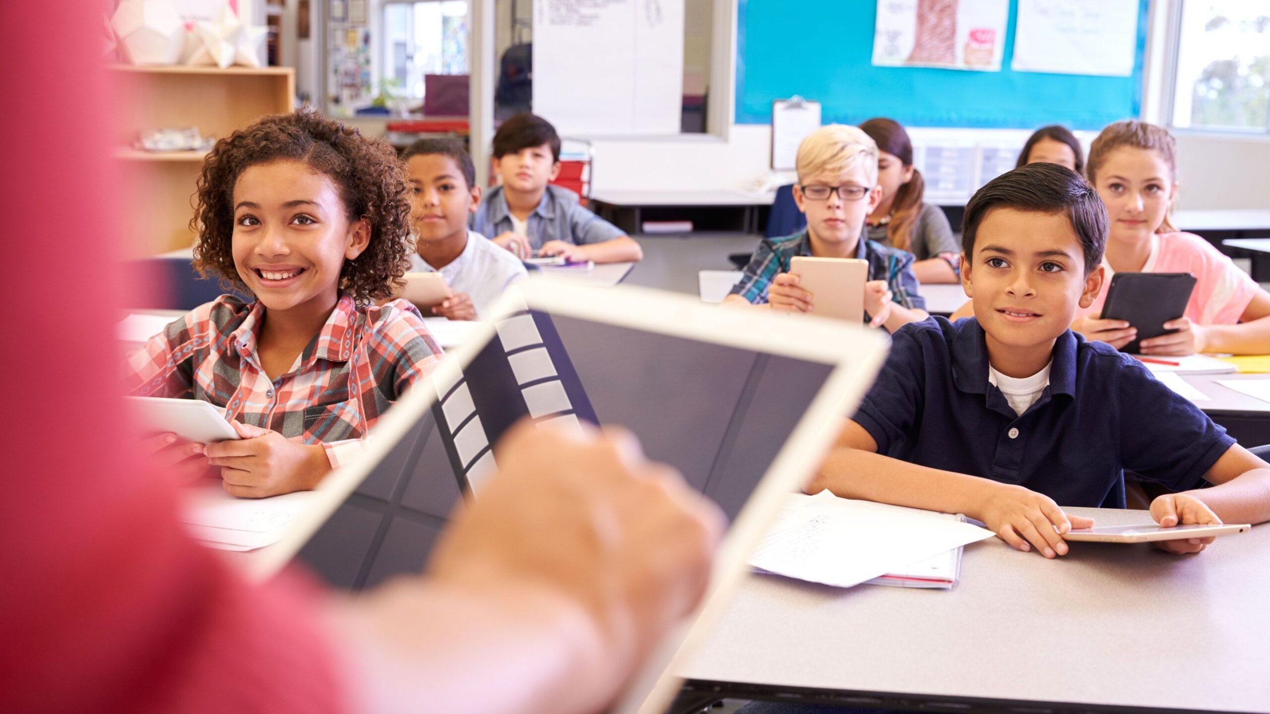 students learning using iPad